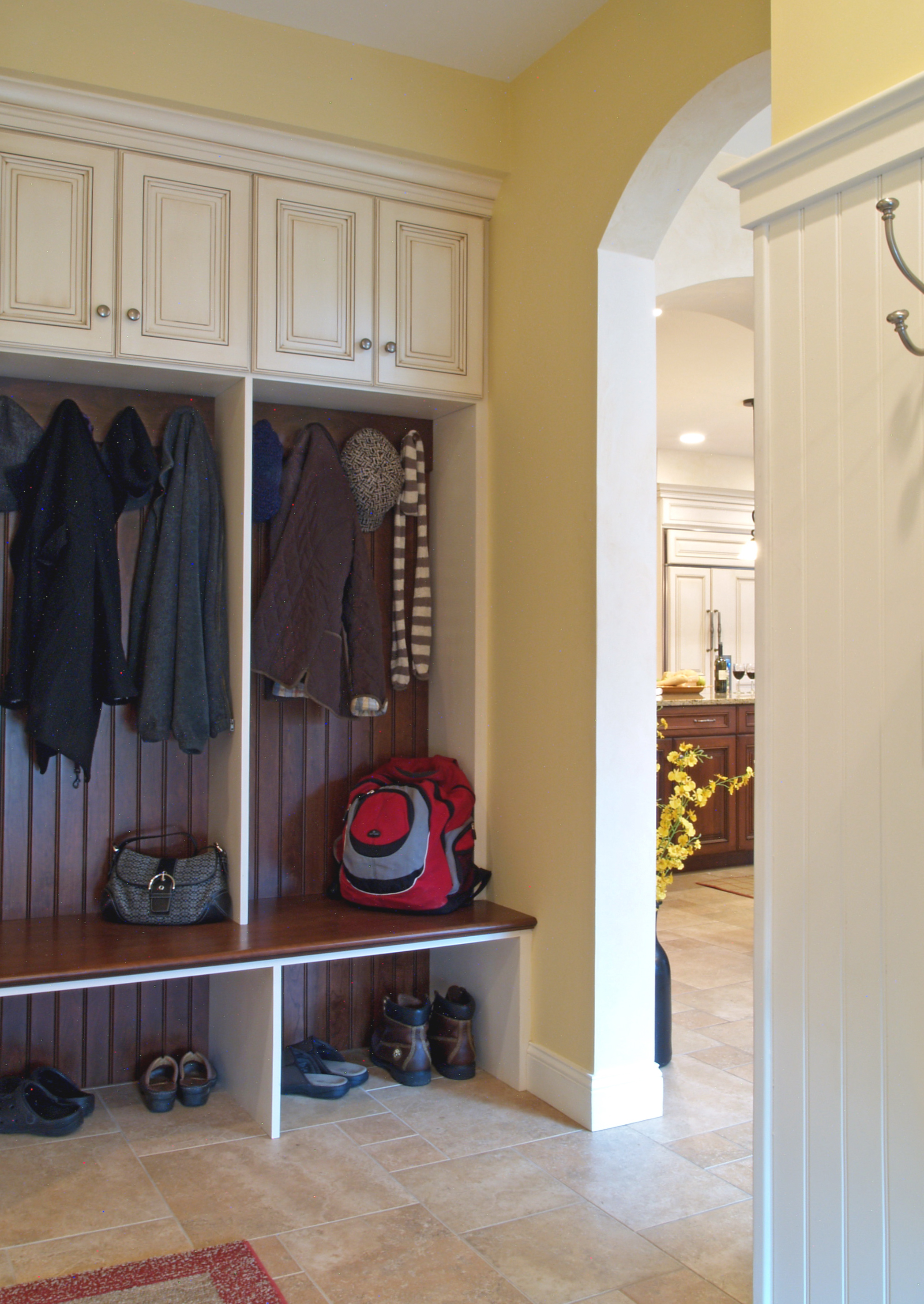 Mudroom with storage cabinets bench and hooks on the level Mud room benches