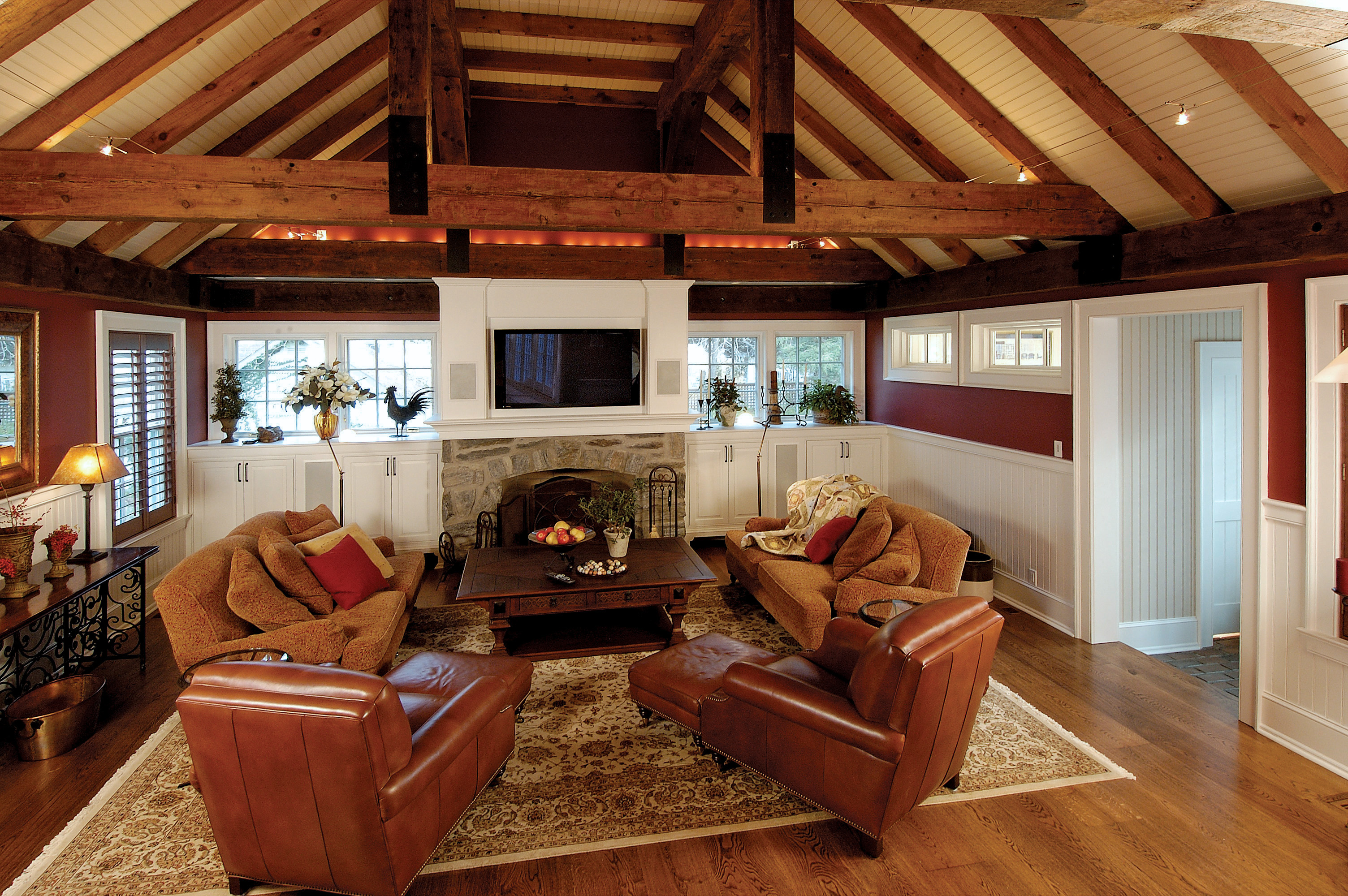 Family room addition with rustic beams and vaulted ceiling for Great room addition off kitchen