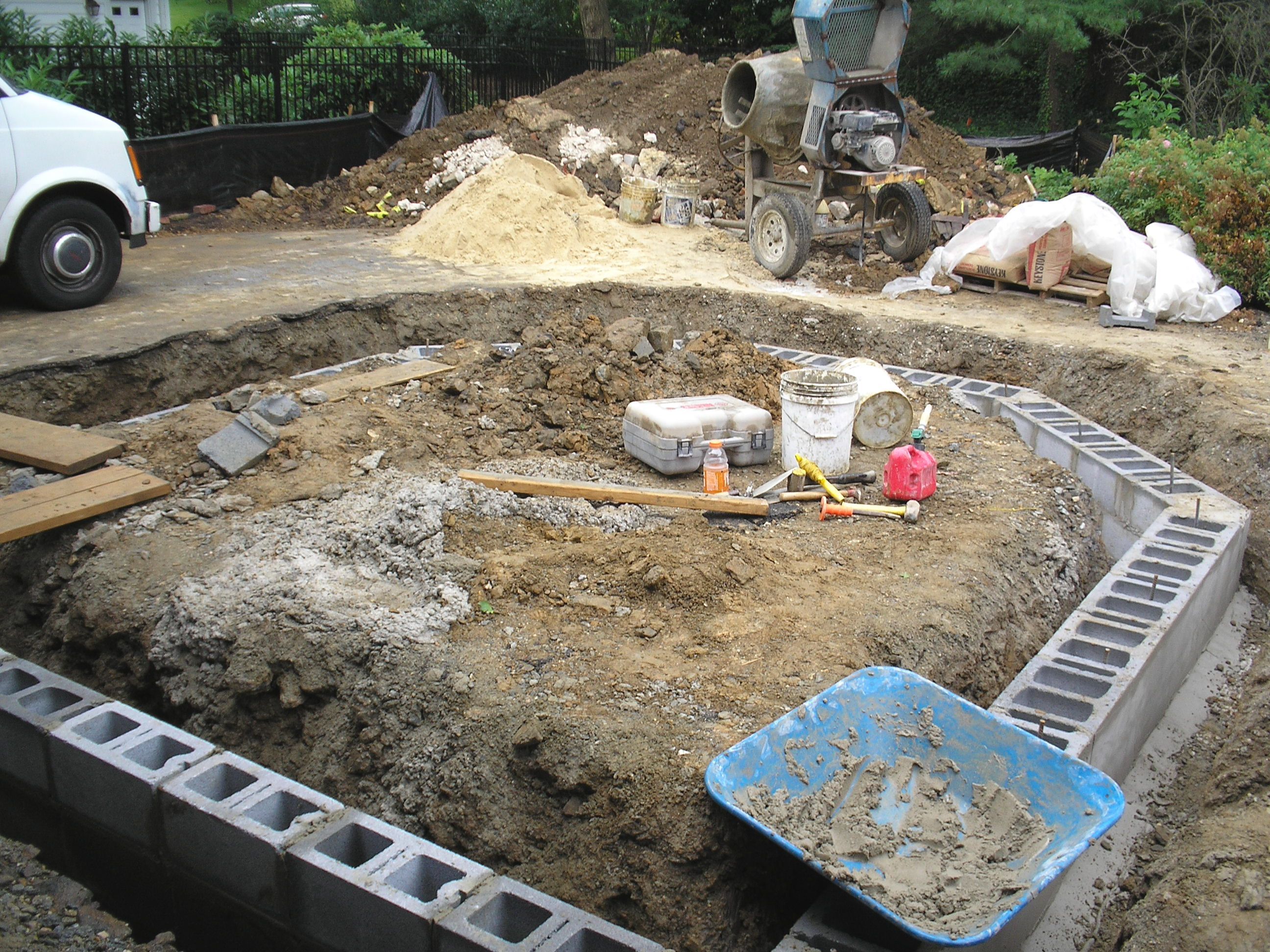 Addition over garage whitby drive renovation for How to build a concrete block wall foundation